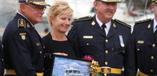 Former OPP Commissioner Chris Lewis (left) stands with his wife and other officers holding a picture of the new OPP marine vessel carrying his name at a ceremony held at the Leamington Marina on June 23, 2016. (Photo by Ricardo Veneza)