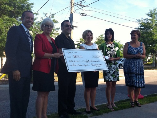The Windsor-St. Clair Rotary Club presents a cheque to Hotel-Dieu Grace Healthcare for a new greenhouse. (Photo by Jason Viau)