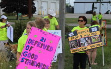 Protesters upset with the OPSCA's application to euthanize 21 dog seized from an alleged dog fighting ring are seen outside the Provincial Offences Court in Chatham on July 21, 2016. (Photo by Ricardo Veneza)