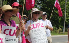 Essex County Library workers rally at the Civic Centre in Essex while on strike on July 7, 2016. (Photo by Ricardo Veneza)