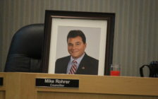 A framed photograph of late Tecumseh councillor Mike Rohrer sits at his seat on council at the regular meeting on July 12, 2016. (Photo by Ricardo Veneza)