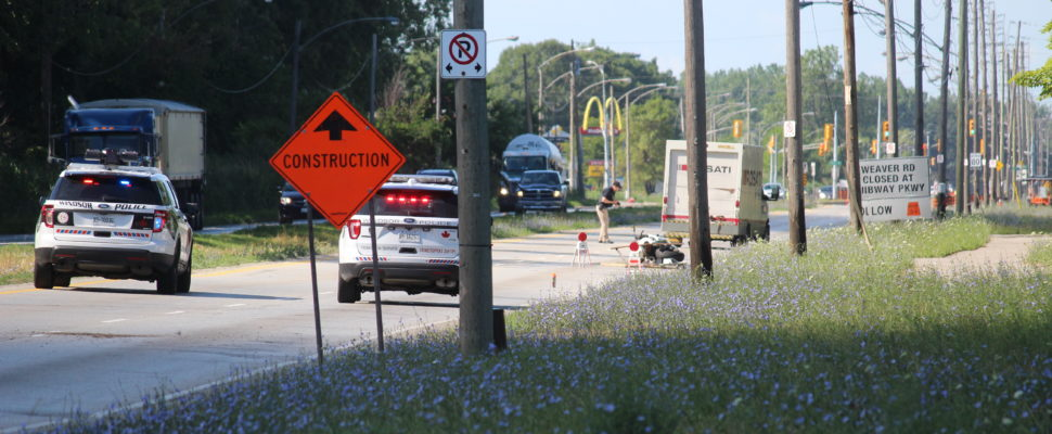 Windsor police investigate a serious motorcycle crash on Ojibway Pkwy. near Broadway Blvd., July 15, 2016. (Photo by Jason Viau)