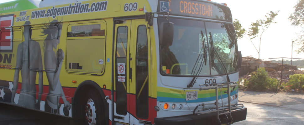 A Transit Windsor bus is seen turning onto Riverside Dr. on July 19. 2016. (Photo by Ricardo Veneza)
