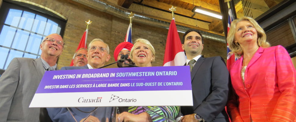Western Ontario Wardens' members Gerry Marshall and Randy Hope, Ontario Infrastructure Minister Bob Chiarelli, Federal Minister of Innovation, Science, and Economic Development Navdeep Bains, MPP Deb Matthews, MP Peter Fragiskatos, and MP Kate Young at the London Roundhouse, July 26, 2016. (Photo by Miranda Chant, Blackburn News.)