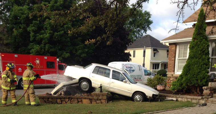 Amherstburg firefighters respond to a crash on Sandwich St. S and Elm, July 14, 2016. (Photo courtesy Amherstburg Fire Department)