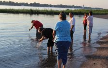 Walpole Island grandmothers praying at the Saint Clair River following the band council's decision to proceed with the Union Gas expansion. August 10, 2016. (Photo by Natalia Vega)