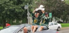 London Knights co-captains Mitchell Marner and Christian Dvorak raise the Memorial Cup during a parade through downtown London, August 25, 2016. (Photo by Miranda Chant, Blackburn News)
