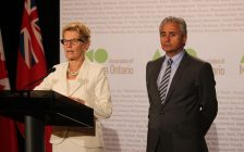 Premier Kathleen Wynne and Minister of Municipal Affairs Bill Mauro speak to media at the AMO Conference, August 15, 2016. (Photo by Maureen Revait)