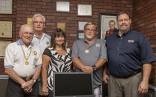 "Dave Bakker and Angie Shreve accepting an ""EZ-Child/Senior Identification Kit"" generously donated by Moose Lodge 1692, Chatham. Pictured left to right: Benny Turato, Jerry Ytsma, Angie Shreve, Govenor Bill Lyons, David Bakker. (Photo courtesy of Design39Media)"