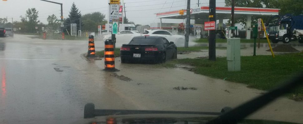 A record rainfall in Tecumseh causes flooding in the town on September 29, 2016. (Photo courtesy OPP)