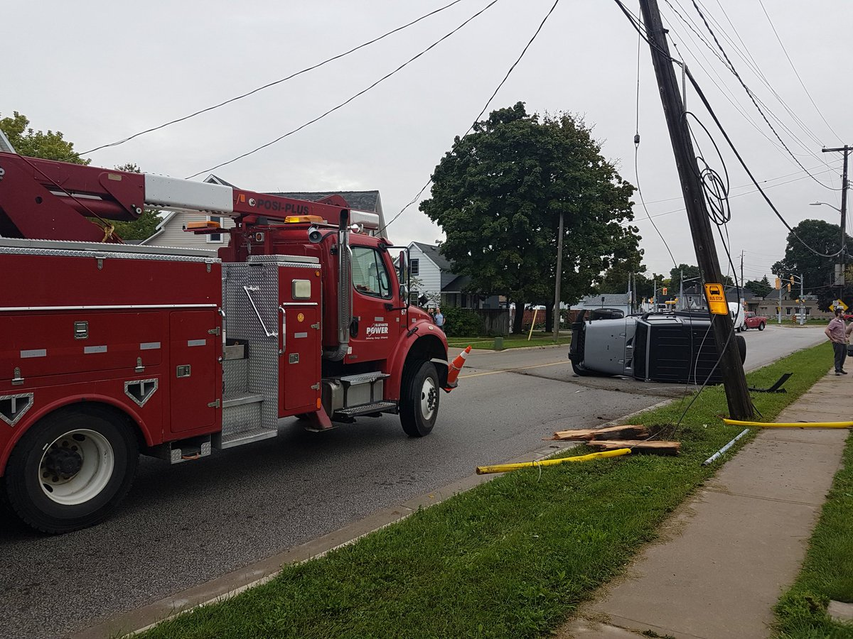 Vehicle Damages Hydro Pole In Rollover