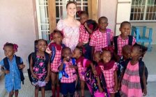 Chatham's Emily Hime poses for a photo with some of the children at Maison Ke Kontan as the get ready for school. October 19, 2015. (Photo courtesy of Emily Hime via Facebook)