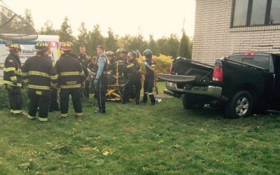 Emergency crews tend to a patient following a collision between a pickup truck and a house in Leamington on Oct 23, 2016 (Photo courtesy of Leamington Fire)