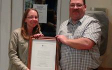 Amy Kieffer receives the Community Activist of the Year Award from Grey Bruce Labour Council President Kevin Smith.