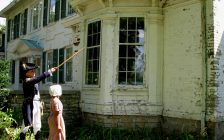 Artist Peter Rindlisbacher (left) and his daughter Victoria (right) tour the grounds of the Belle Vue House in Amherstburg in costume. (Photo courtesy Belle Vue Conservancy)