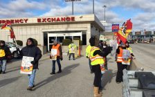 Members of PSAC Local 501 picket at the Blue Water Bridge Currency Exchange after walking off the job. Monday November 21, 2016 BlackburnNews.com photo by Melanie Irwin