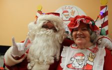 Scott Powers (left), also known as Deaf Santa, and his mother Mary Powers (right) hold a Deaf Santa event at Cheese Wheelz pizzeria downtown Windsor on November 17, 2016. (Photo by Ricardo Veneza)