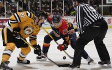 Ryan McGregor of the Sarnia Sting (left) fights for a faceoff puck against Gera Poddubnyi of the Erie Otters at Progressive Auto Sales Arena in Sarnia, Nov 19, 2016 (Photo courtesy of Metcalfe Photography)