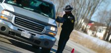OPP officer checking to see if someone has been drinking during a R.I.D.E. spotcheck. (Photo © Can Stock Photo / Crysrob)