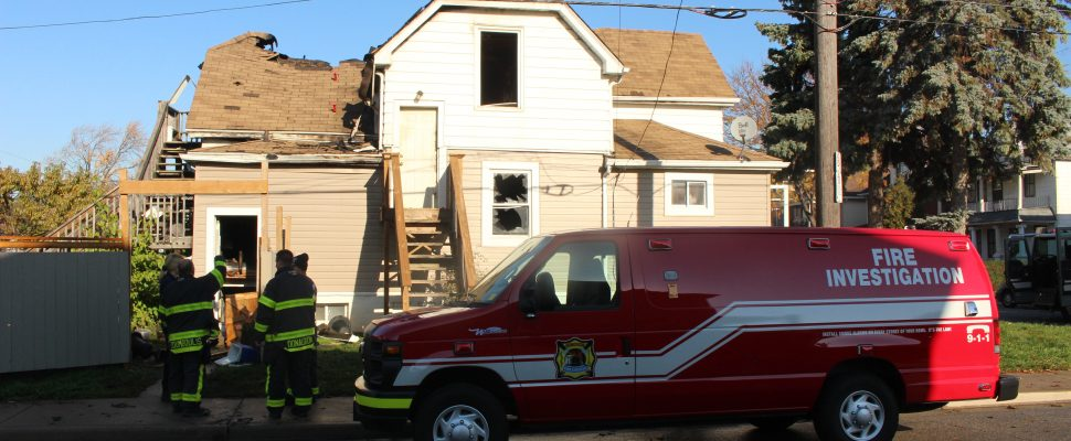 Windsor Fire And Rescue Service Investigators take a look at a duplex fore on Cataraqui St. at Pierre Ave., November 7, 2016. (Photo by Mike Vlasveld)