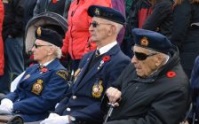 Veterans sit and watch as the Remembrance Day ceremony in Port Elgin commences. (Photo by Jordan Mackinnon)