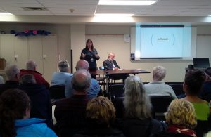 Dr. Erica Clark addresses a crowd in Clinton Tuesday night about the Huron County Health Unit wind turbine study. (photo by Bob Montgomery)