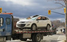 An SUV is towed away after a crash that sent it onto its side at York St. and Ridout St. in London, December 2, 2016. (Photo by Miranda Chant, Blackburn News.)