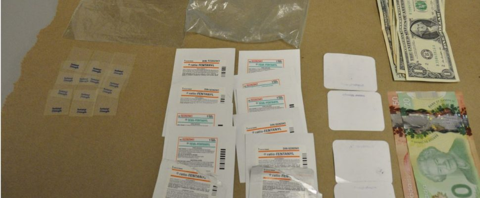 Fentanyl patches and cash seized by London police.