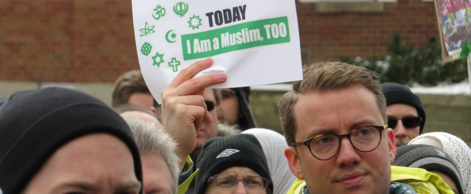 A London man holds up a sign of hope at solidarity rally at the London Muslim Mosque, January 30, 2017. (Photo by Miranda Chant, Blackburn News.)