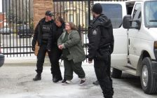 Elizabeth Wettlaufer is escorted into the Woodstock courthouse, January 13, 2017. (Photo by Miranda Chant, Blackburn News)