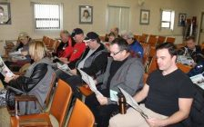 Employees in Drive-Away and TCT of Auto Warehousing Company in Windsor review contract details during a vote meeting at the local's hall in Windsor, Jan 15, 2017 (Photo courtesy of Unifor Local 444/Facebook)