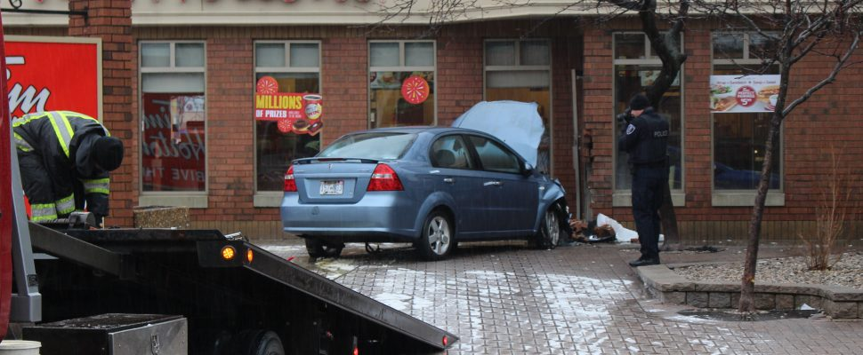 A car, which the Windsor Police Service says was stolen, ends up slamming into a Tim Hortons on Park St. W. at Goyeau St., February 7, 2017. (Photo by Mike Vlasveld)