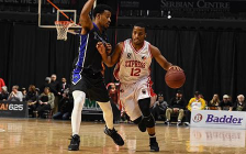 Darren Duncan of the Windsor Express (right) dribbles past a Kitchener-Waterloo Titans player during Windsor's 85-74 win Feb 12, 2017 at the WFCU Centre (Photo courtesy Windsor Express)