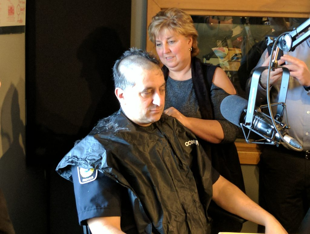 CHOK's Sue Storr shaves Constable John Sottosanti's head live on air to kick of the Shave For The Brave Event.