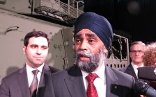 Canadian Defence Minister Harjit Sajjan and London North Centre MP Peter Fragiskatos speak to reporters at General Dynamics Land Systems in London, February 10, 2017. (Photo by Miranda Chant, Blackburn News.)