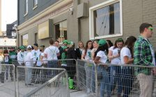 A group of St. Patrick's Day revellers lined up outside of The Ceeps on Richmond Row, March 17, 2017. (Photo by Miranda Chant, Blackburn News.)