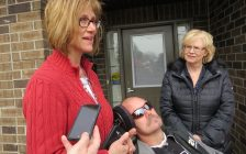 Tanya Dallaire speaks about her brother Shawn Eyre's physical disability while London West MPP Peggy Sattler looks on at a news conference outside of Participation House in London, March 24, 2017. (Photo by Miranda Chant, Blackburn News.)