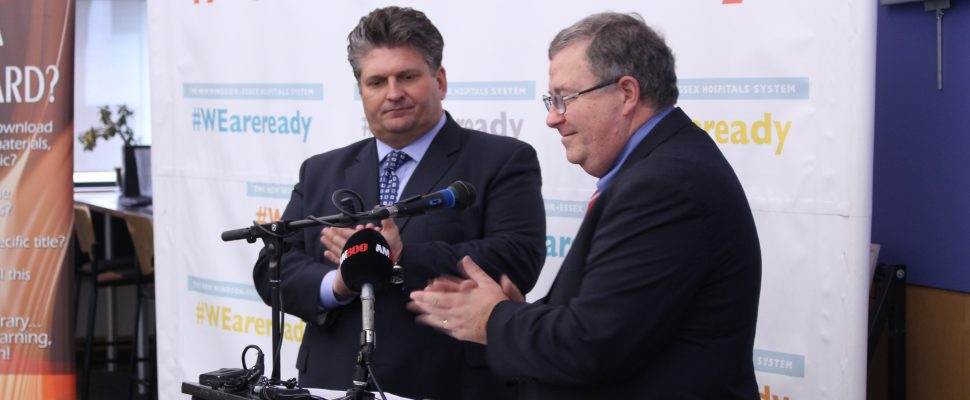 Windsor Regional Hospital CEO David Musyj (left) and Windsor Public Library Board Chair Peter Frise speak about a new partnership, March 6, 2017. (Photo by Mike Vlasveld)
