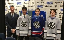 From L-R: Joe Birch, OHL Senior Director of Hockey Development and Special Events, 1st overall pick Ryan Suzuki of the Barrie Colts, 5th overall pick Phil Tomasino of the Niagara Ice Dogs, and 30th overall pick Keean Waskurak of the Mississauga Steelheads. (Photo by Ryan Drury)