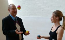 Larry Horwitz of the Downtown Windsor BIA tries juggling with Tia Nicoletti of the Windsor Circus School at the Chelsea Building in Windsor, April 13, 2017 (Photo by Mark Brown/Blackburn News)