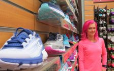 Angie Hopf, store manager of the Running Room on Richmond St. shows off the store's many running shoes, April 17, 2017. (Photo by Miranda Chant, Blackburn News.)