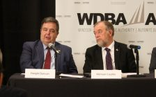 President and CEO of the Windsor-Detroit Bridge Authority Michael Cautillo (right) and WDBA Chair of the Board Dwight Duncan (left) at the WDBA Annual Public Meeting, April 28, 2017. (Photo by Mike Vlasveld)