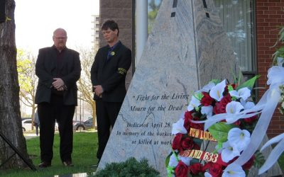 Len Elliott, regional vice president of the Ontario Public Service Employees Union, and Dan Stephens, chair of the London and District Labour Council observe a moment of silence at the Workers' Mourning Day monument on Adelaide St., April 28, 2017. (Photo by Miranda Chant, Blackburn News)