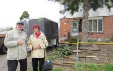 Joseph and Pauline Morello stand in front of their damaged Culver Dr. home. A vehicle crashed into the home early April 19, 2017. (Photo by Miranda Chant, Blackburn News.)