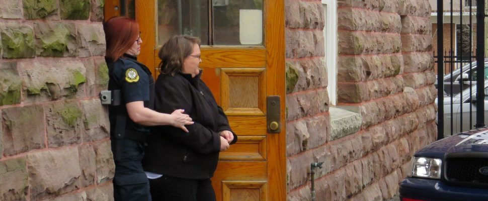 Elizabeth Wettlaufer is escorted out of the Woodstock courthouse, April 21, 2017. (Photo by Miranda Chant, Blackburn News)