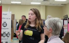 Bethany Gunn explaining her project at the school science fair in Owen Sound. (Photo by Kirk Scott)
