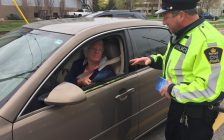 CN Police Constable Bruce Middleton hands motorists pamphlets on rail safety during a traffic enforcement activity on Front St. Tuesday, April 25, 2017 BlackburnNews.com photo by Melanie Irwin