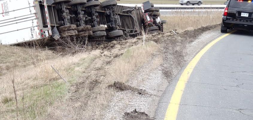 Tractor trailer rollover closes eastbound 401 off-ramp at Bloomfield Rd., Wednesday April 5, 2017. (Photo courtesy of OPP.)