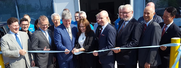 Cutting the ribbon is the Honourable Glen Murray, Minister of Environment and Climate Change, and Cara Clairman, Plug 'n Drive's President and CEO.  Mike Rencheck, Bruce Power President and CEO is second from right.  (photo submitted)