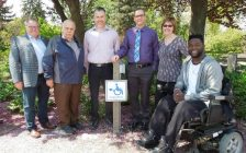 (Left to right) at the outdoor Charge Station at the Strangway Centre in Sarnia of: Bill Weber, Warden, County of Lambton; Councillor Lonny Napper, Chair, County of Lambton Accessibility Advisory Committee; Brian White, Sarnia City Councillor and Member of the Sarnia Accessibility Advisory Committee; Dale Mosely, Accessibility Coordinator, City of Sarnia; Heather Allen, Supervisor, Program Review & Compliance, County of Lambton; Dan Edwards, Local Accessibility Advocate. (County of Lambton supplied photo.)